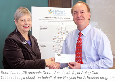 Scott Larson presenting a check to Aging Care Connections