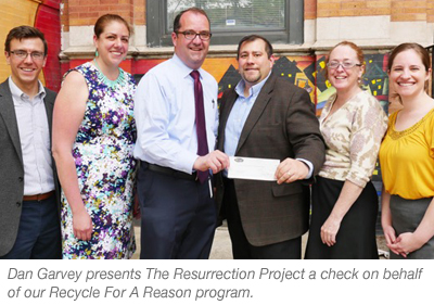 Dan Garvey presents The Resurrection Project a check on behalf of our Recycle for a Reason program